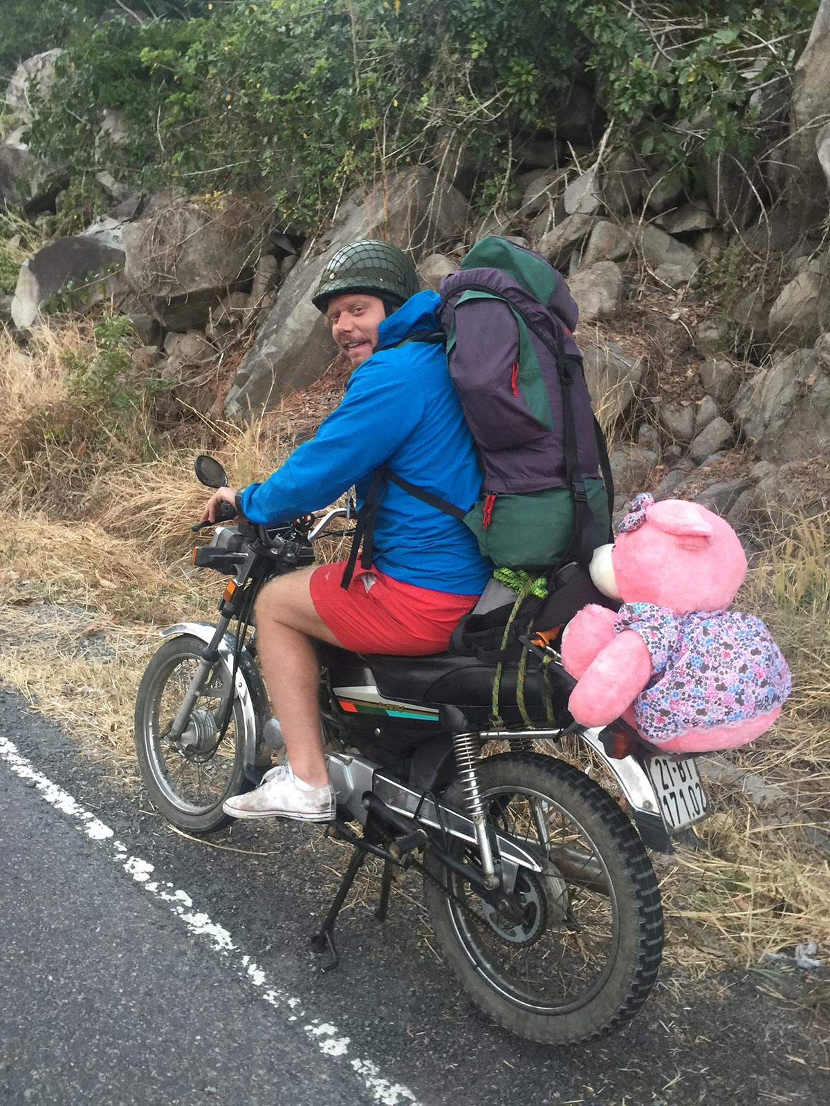 A friend and pink teddy riding the motorbike in Da Lat, Vietnam. Night rider and a broken bike