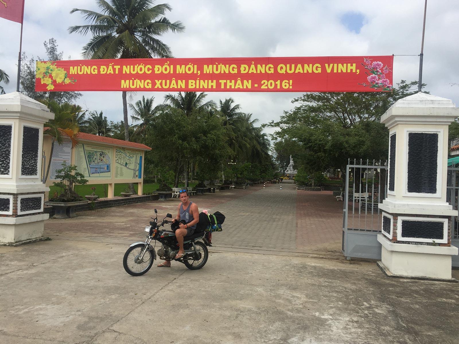 David Simpson riding a motorbike in Quy Nhon, Vietnam. The Vietnamese clubs