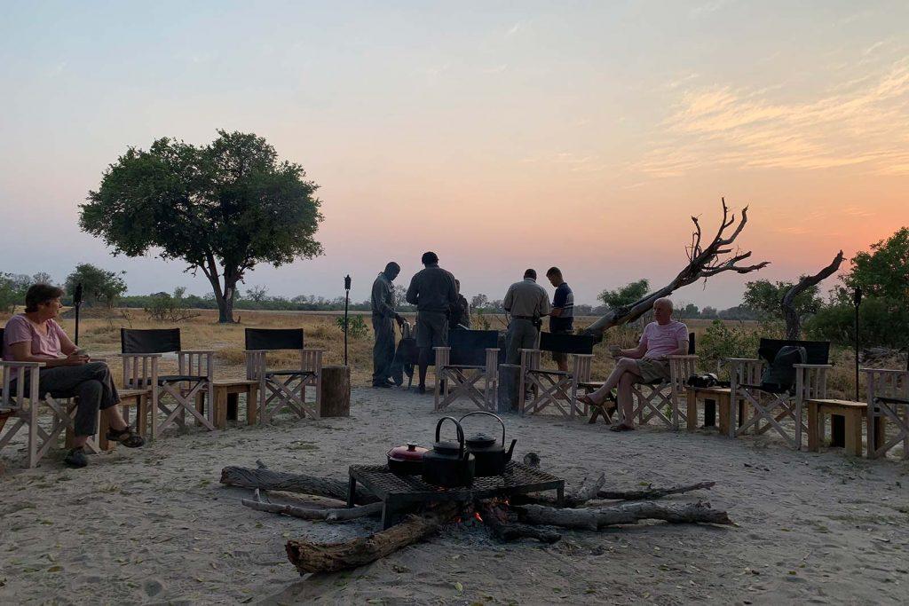 Preparing dinner in the bush in Botswana, Africa. Cheetah, cubs & the most incredible dinner setting