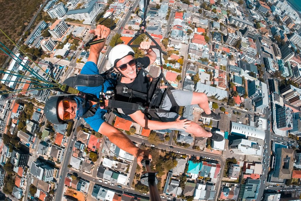 David Simpson paragliding in Cape Town, South Africa. South Africa reflection