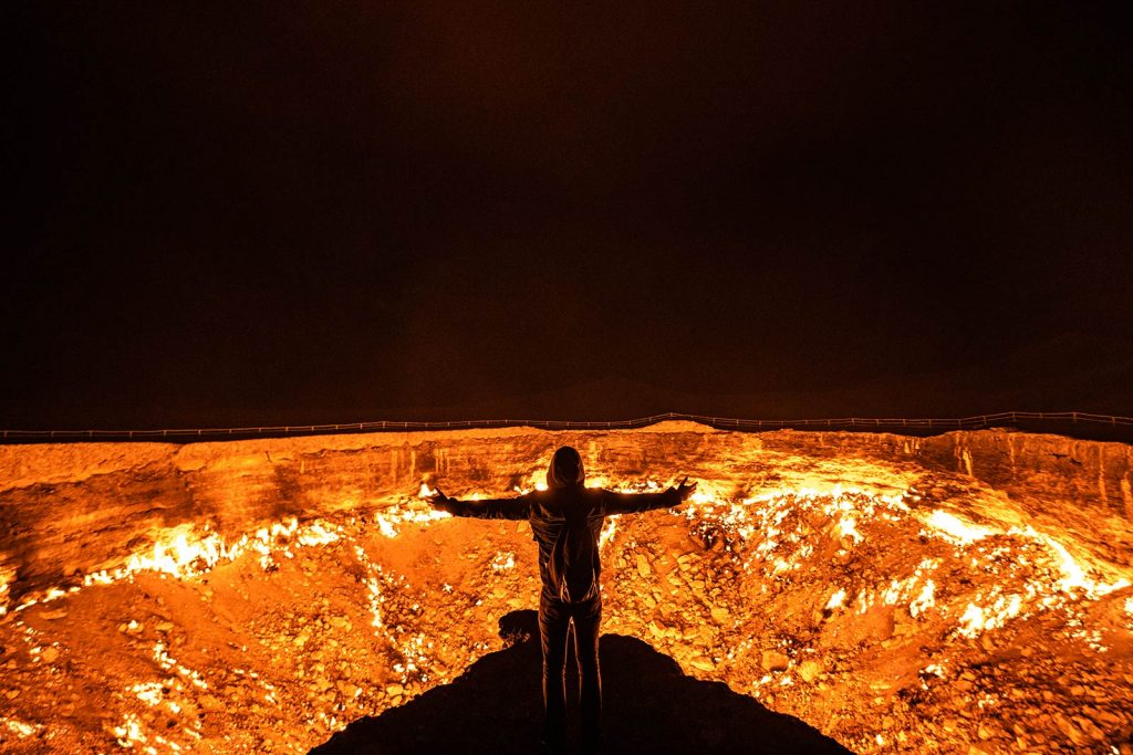 David Simpson and the gas crater in Darvaza, Turkmenistan. The gates of hell