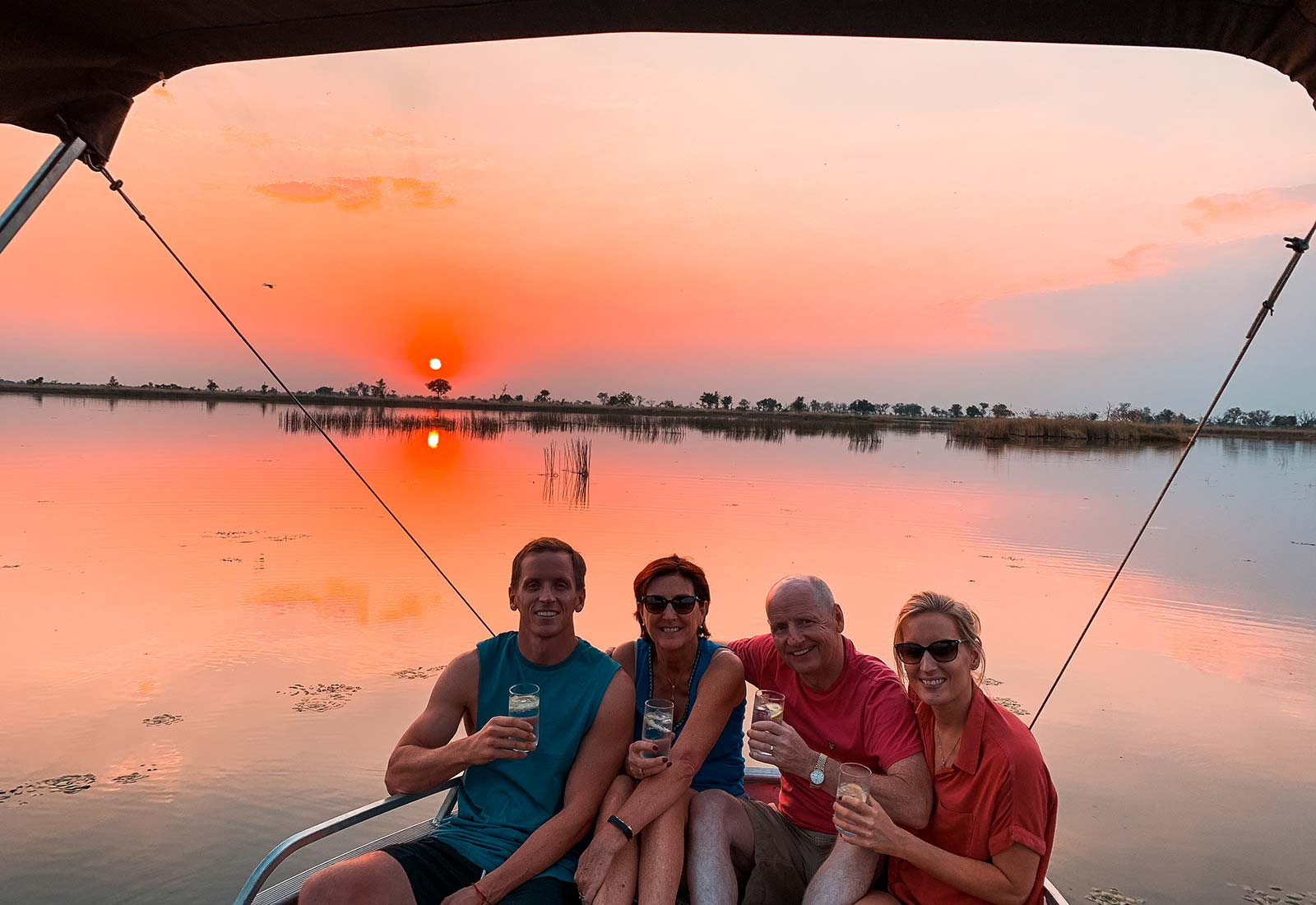 David Simpson and family at sunset in Okavango Delta in Botswana, Africa. An owl and African sunsets