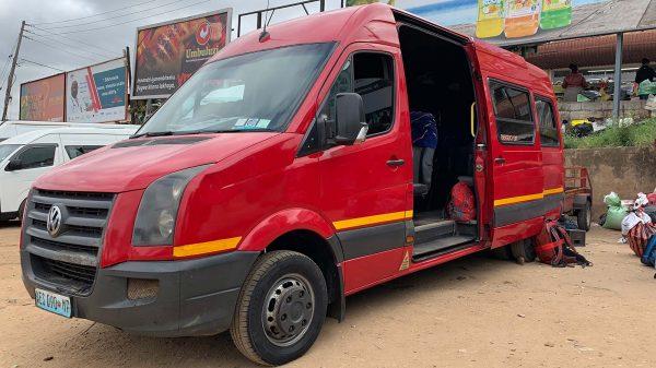 Red minivan in Manzini, Eswatini. The £4 bus that cost me £700