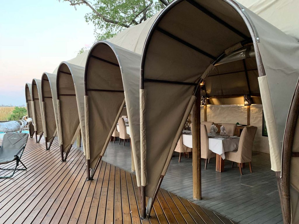 Tent lodge at game reserve in Botswana, Africa. Sh*ting next to an elephant