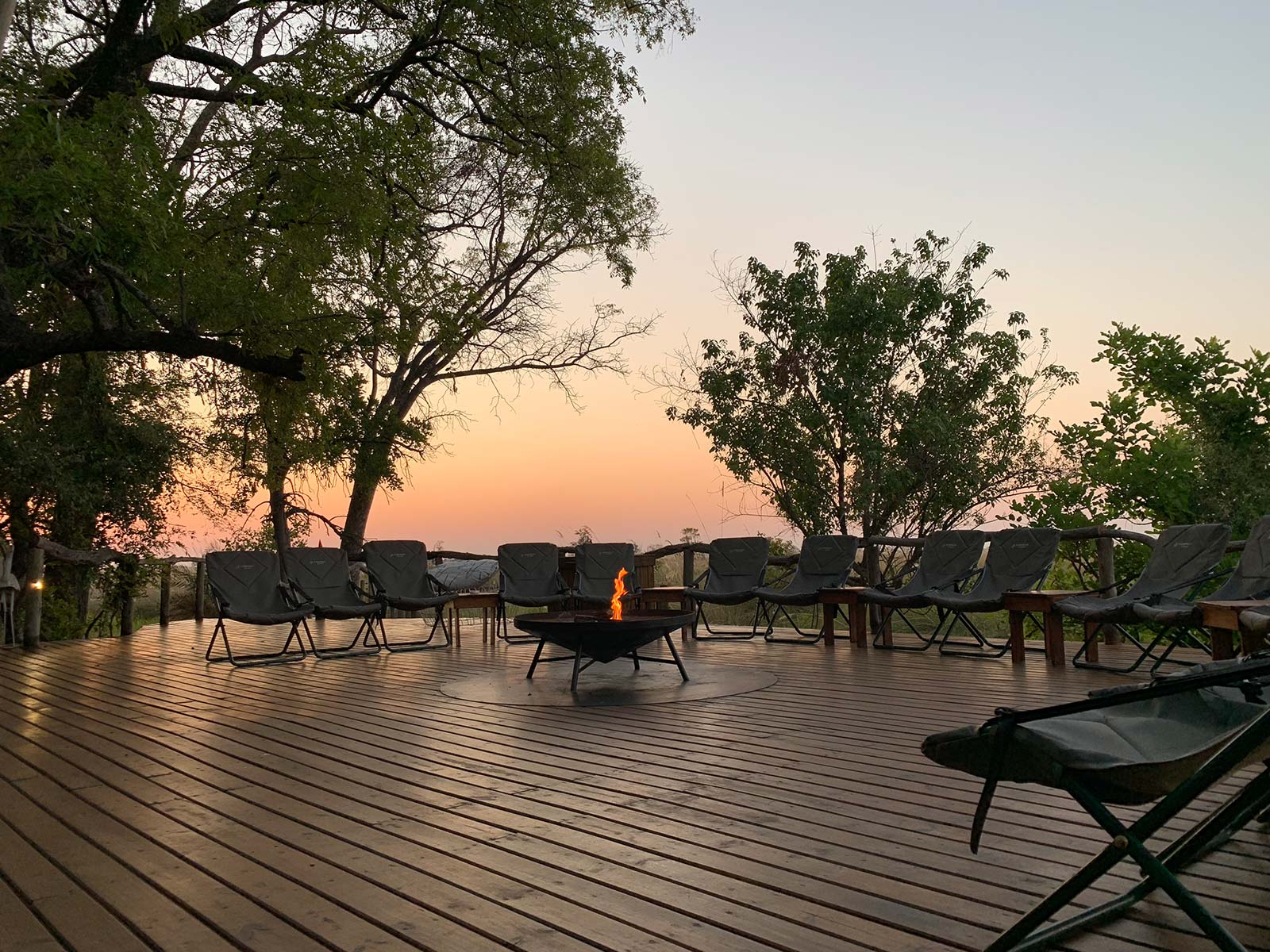 Chairs around a bonfire at game reserve in Botswana, Africa. Sh*ting next to an elephant