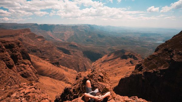 David Simpson enjoying the view on top of the Ampitheater in Lesotho, Africa. The greatest hike on Earth?