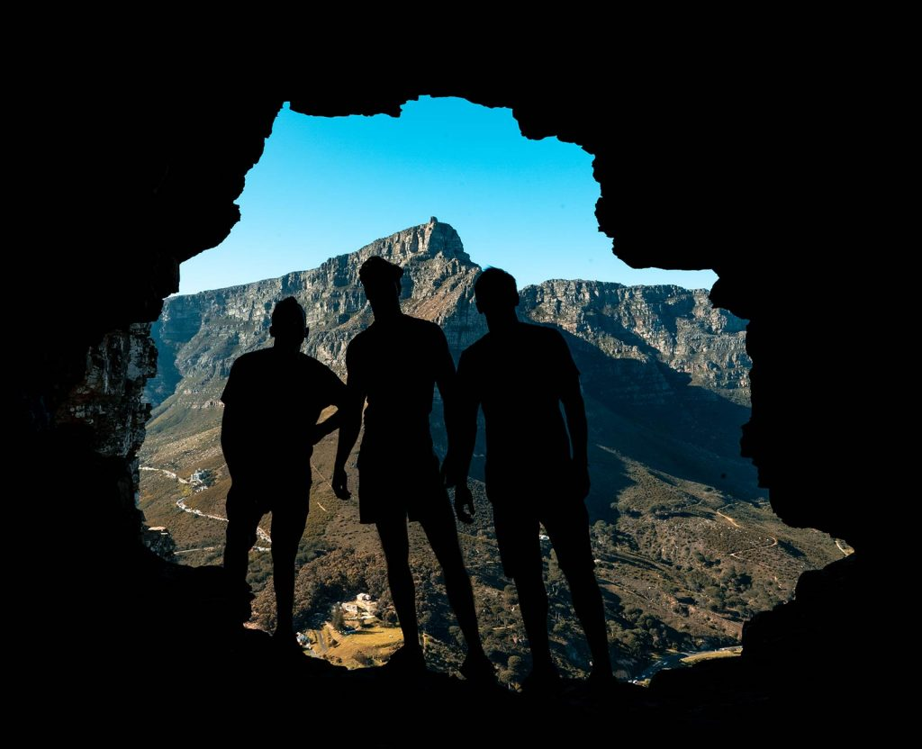 David Simpson and friends in Wally's Cave at Lion's Head in Cape Town, South Africa. South Africa reflection