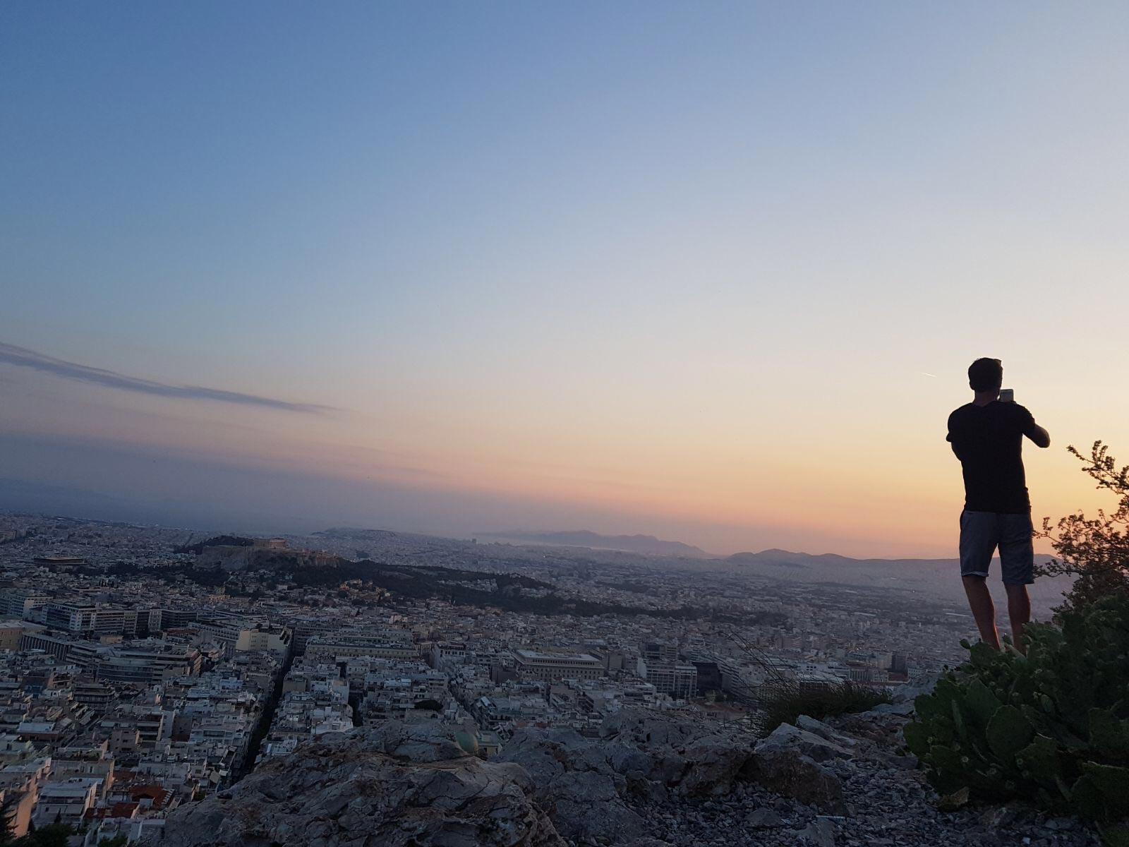 David Simpson on top of Mount Lycabettus at sunset in Athens, Greece. Athens has me