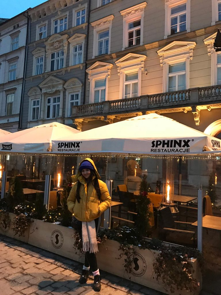 Niece at Main Square in Krakow, Poland. Cold walks and Polish food in Krakow